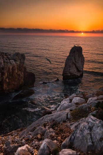 Sunset Landscape Seascape Italia Sardegna Landscape_Collection Sunset EyeEm Selects Sea Water Sunset Sky Rock Rock - Object Beauty In Nature Horizon Scenics - Nature Beach Tranquil Scene Cloud - Sky Nature Land Tranquility
