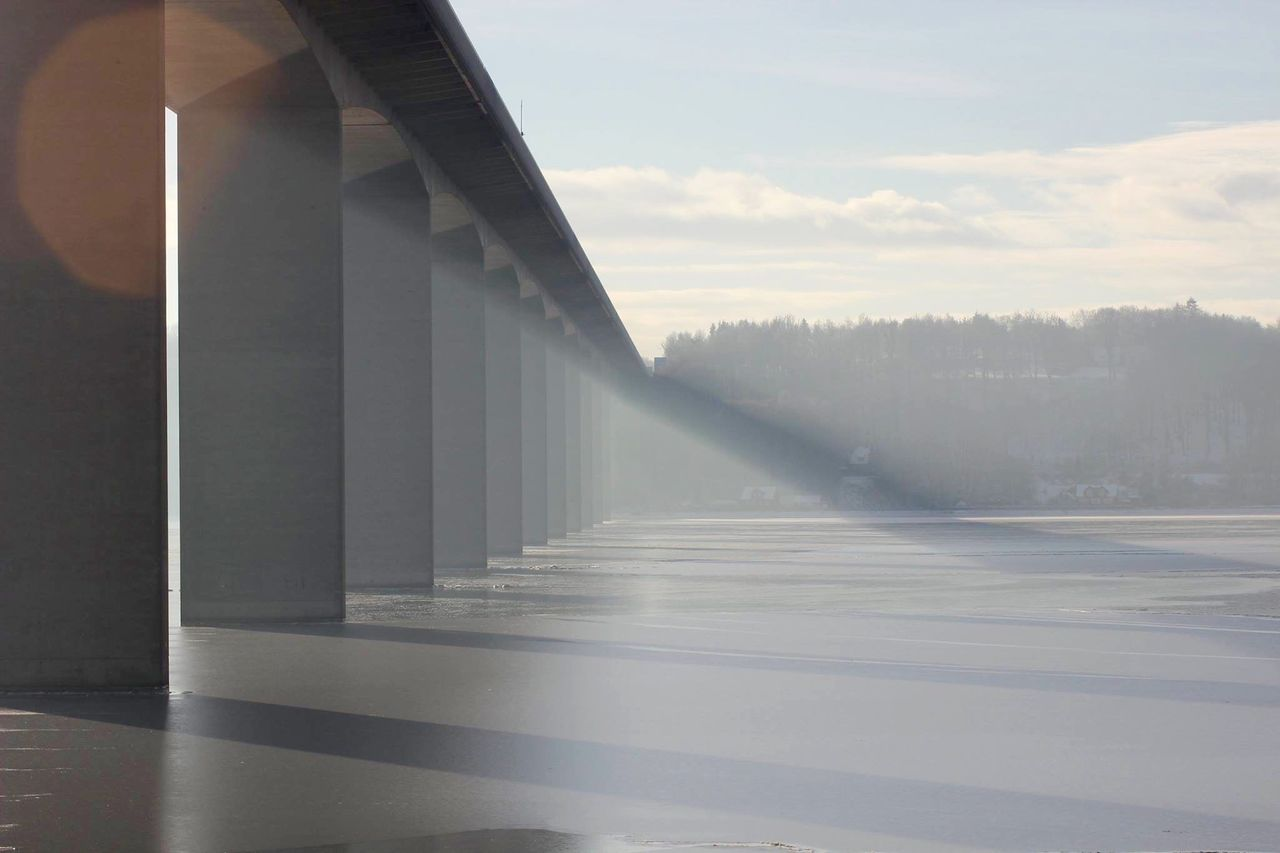 Low Angle View Of Bridge Over River On Sunny Day