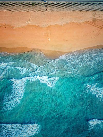 Aerial View Of Sea Waves Rushing At Beach