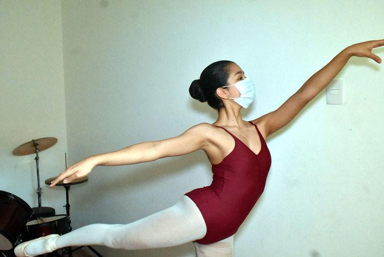 Dancer practicing indoors.