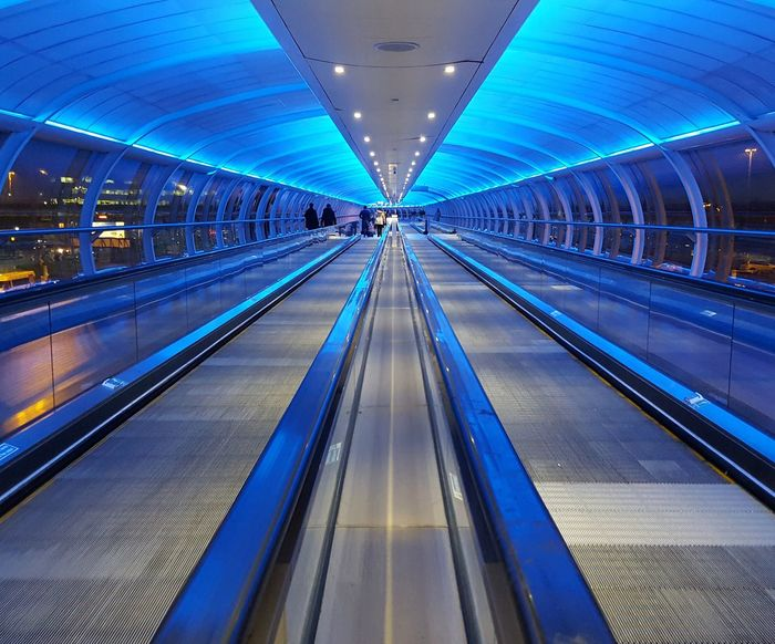 Travelators at Manchester Airport Blueglow Manchester Airport Travelators Tunnel Tunnel Vision Tunnel View Tunnelvision Transportation Airports Travelators Connection