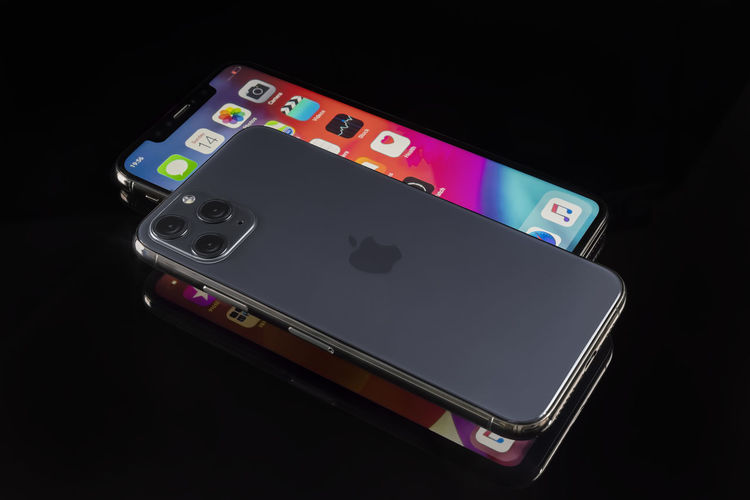 High angle view of smart phone against black background