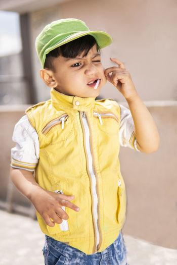 Full length of a boy holding mobile phone