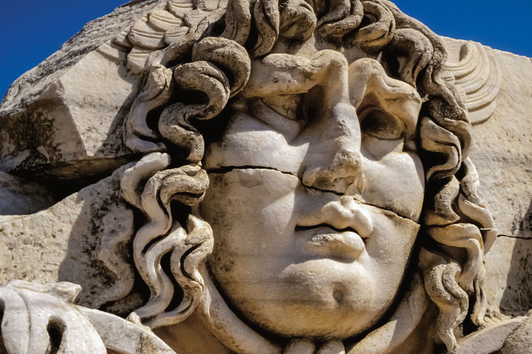 Face carved on marble in classical style by ancient greeks at the apollo's temple in didyma, turkey.