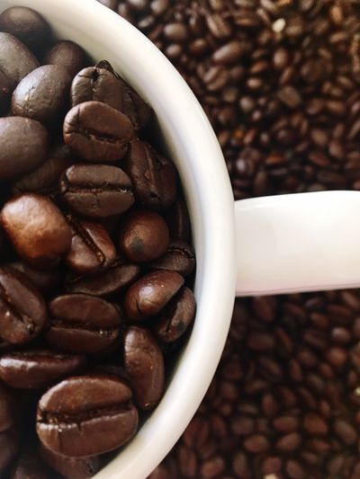 Close-Up Of Roasted Coffee Beans In Cup