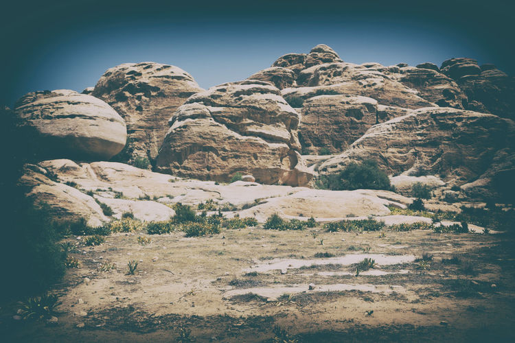 Low angle view of rocks against clear sky