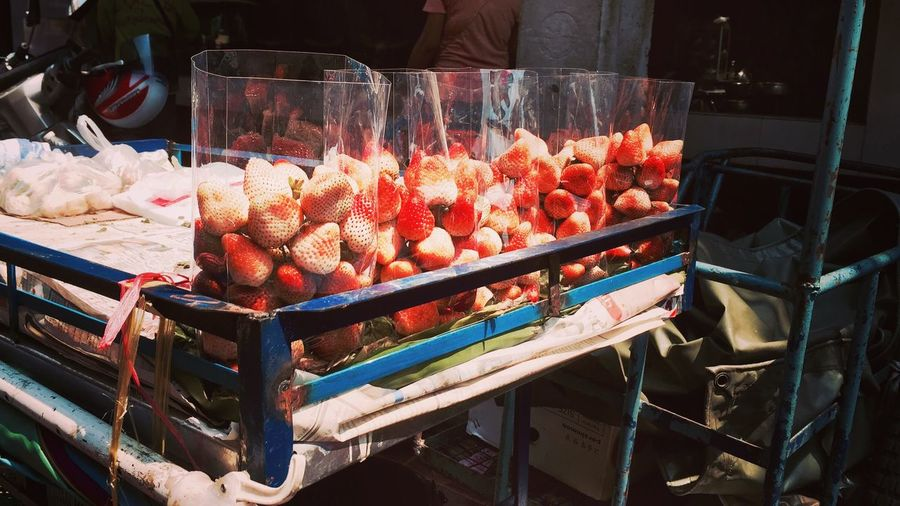 Strawberries in containers for sale at market