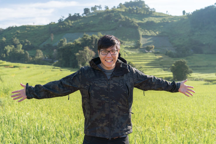 Travel ASIA Asian  Thailand Thai Army Soilder Smiling One Person Plant Front View Land Field Happiness Leisure Activity Real People Emotion Three Quarter Length Green Color Standing Lifestyles Nature Grass Day Landscape Young Adult Looking At Camera Human Arm Outdoors