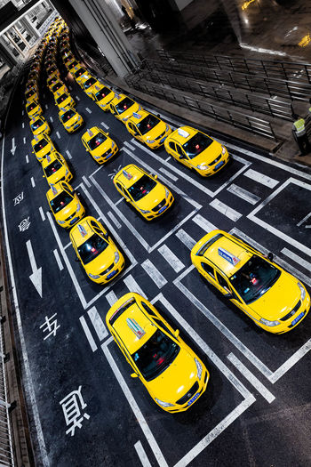 High angle view of yellow car on street