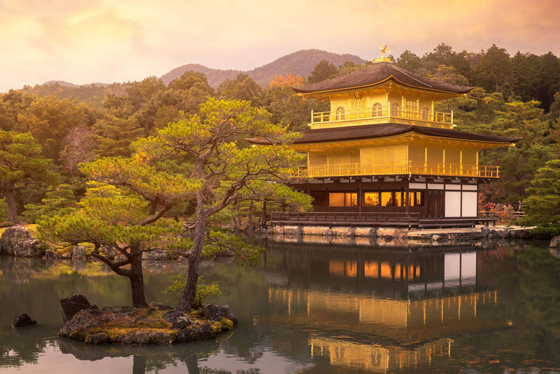Kinkakuji Temple the temple of the Golden Pavilion a buddhist temple in Kyoto,Japan Ancient Golden Japan Japan Photography Kinkakuji Temple Tradition Architecture Beauty In Nature Buddhism Building Exterior Built Structure Day Kinkakuji Kyoto Lake Mountain Nature Outdoors Pavillion Scenics Sky Sunset Travel Destinations Tree Water