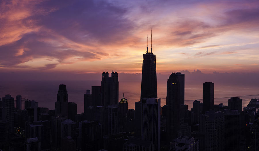 Early Morning Building Exterior Built Structure City Sky Architecture Sunset Office Building Exterior Skyscraper Building Tower Cityscape Urban Skyline Modern Tall - High Cloud - Sky Travel Destinations Landscape No People Downtown District Nature Spire  Outdoors Financial District  Romantic Sky