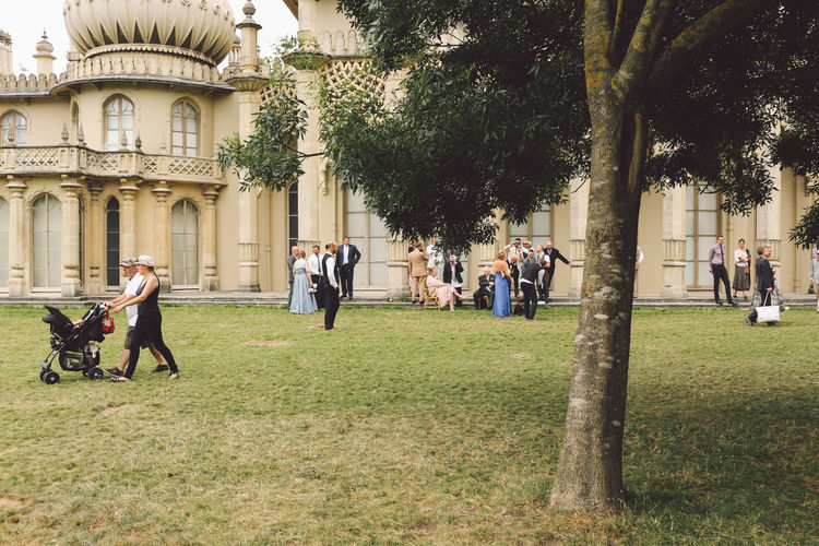 Architecture Brighton Built Structure City City Life Day Grass Green Color Group Of People Large Group Of People Lawn Leisure Activity Lifestyles Medium Group Of People Mixed Age Range Outdoors Park Park - Man Made Space Person Royal Pavilion Royal Pavilion Gardens Sky Tourism Tourist Tree