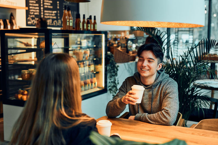 Portrait of woman with coffee cup in restaurant