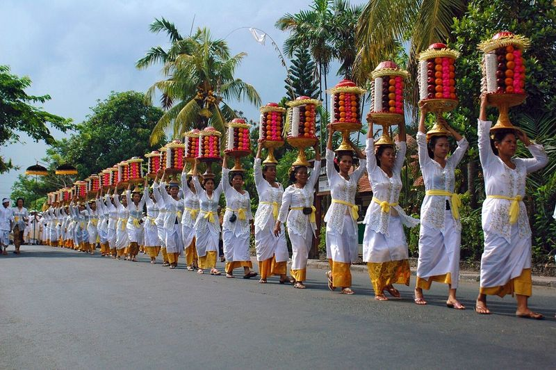 Women walking in row while carrying fruits on head