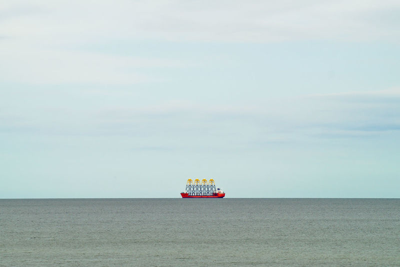 View of ship at sea against sky