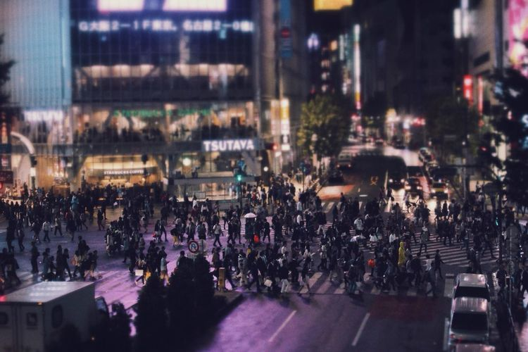 Tilt-shift image of people on city street