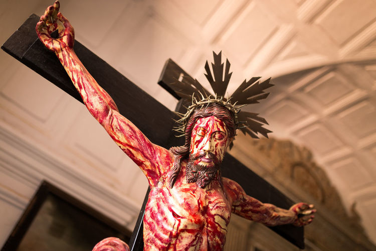 Blood covered Jesus Christ in a church in Goa, India Bleeding Blood Christianity Christmas Church Covered Cross Crucifix Famous Place Goa Holy India Indian INRI Jesus Jesus Christ Place Of Worship Sacred Spirituality Suffering Tourism Tourist Attraction  Travel Destinations Unesco Worship
