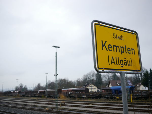 Town sign Kempten (allgäu) Trafficsign in south Germany Allgäu Guiding Kempten (Allgäu) Traffic Cold Temperature Communication Day Guidance Guide Kempten No People Outdoors Rail Transportation Railroad Track Road Sign Sky Snow Text Traffic Sign Transportation Yellow