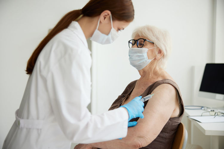 Midsection of woman wearing mask