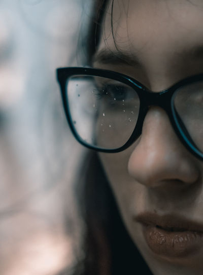 Close-up of young woman wearing eyeglasses