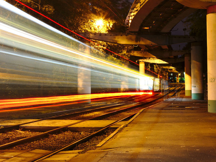 Blurred Motion Of Train At Railroad Station During Night