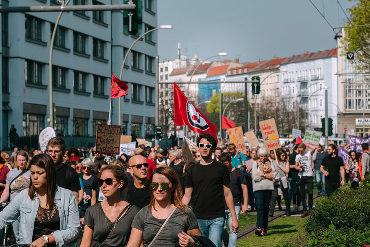 Group of people against buildings in city