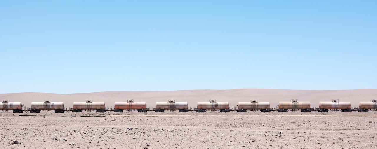 Freight Train On Desert Against Clear Blue Sky