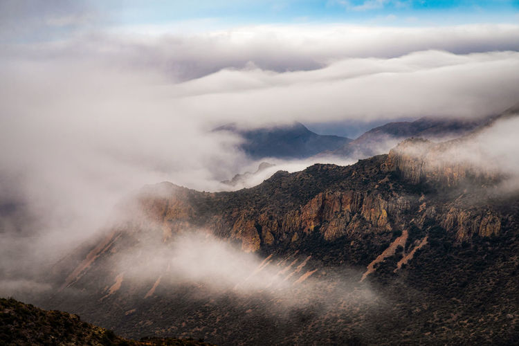 Scenic view of foggy mountain against sky in big bend national park - texas
