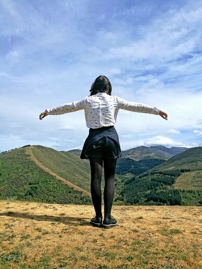 Full Length Rear View Of Woman Standing On Mountain