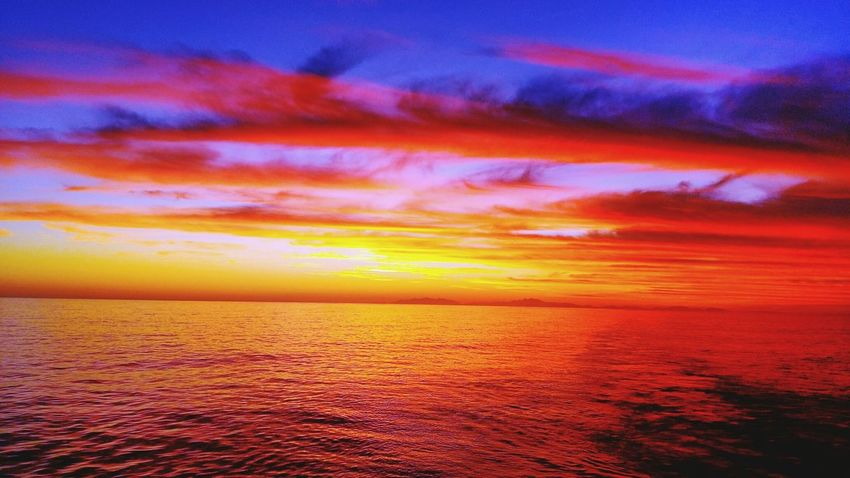 Sea Horizon Over Water Dramatic Sky Nature Scenics Multi Colored Tranquility Red Moody Sky Atmospheric Mood Blue Sky