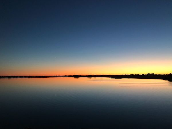 Fehmarn No Edit/no Filter Sky Scenics - Nature Beauty In Nature Water Tranquility Tranquil Scene Reflection Waterfront Lake Sunset Nature No People Blue Idyllic Copy Space Non-urban Scene Clear Sky Outdoors Salt Flat