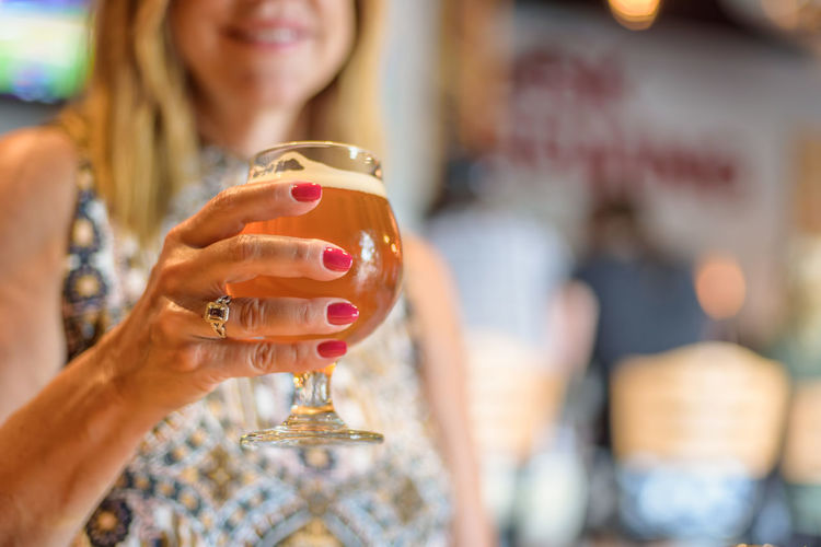 Close-Up Of Woman With Beer