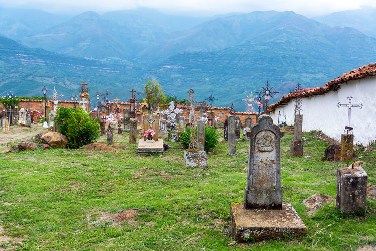 GUANE, COLOMBIA - MAY 14: View of the cemetery in the town of Guane, Colombia on May 14, 2016 Barichara...santander Christian Colombia Cross Death Grass Grave Green Peace Santander Tomb Barichara Cementery Graves Gravestone Graveyard Guane Headstone Historic Memory Religion Rest Stone Tombstone Town