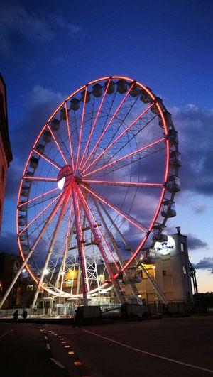 Ferris Wheel Arts Culture And Entertainment Amusement Park Circle Night Dusk Amusement Park Ride Illuminated Sky No People Low Angle View Sunset Outdoors City