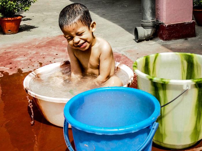 Boy Sitting In Tub
