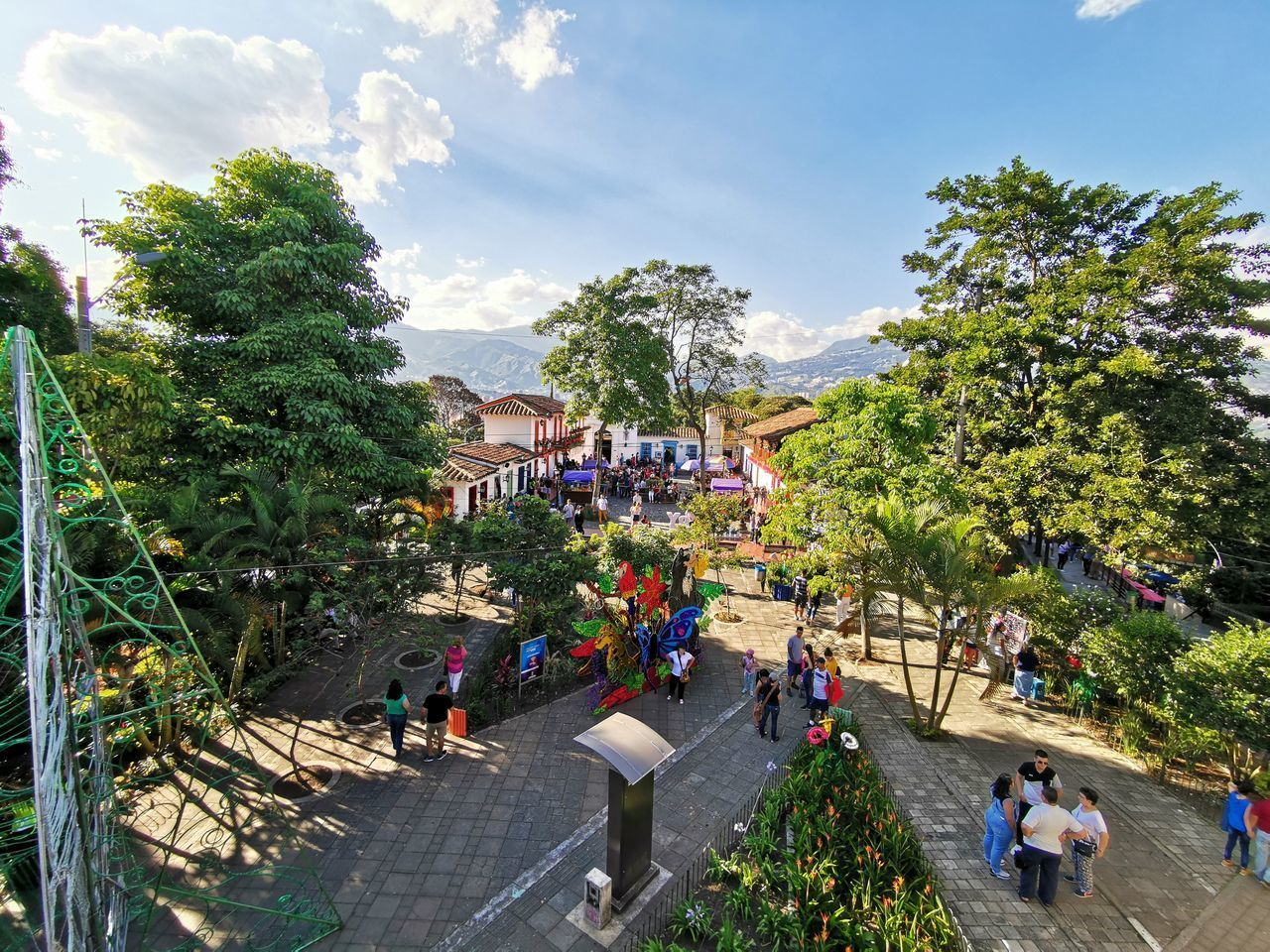 plant, tree, group of people, sky, nature, real people, men, women, adult, leisure activity, day, cloud - sky, crowd, lifestyles, growth, architecture, large group of people, green color, high angle view, outdoors