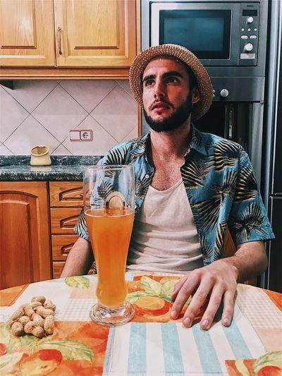 Man With Drink In Kitchen
