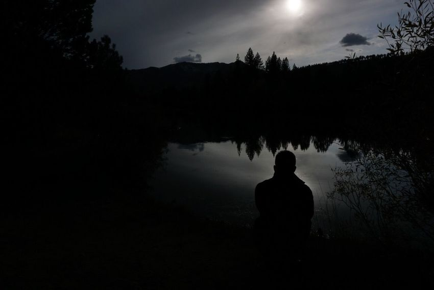 Lost In The Landscape Nofilter Silhouette Tree Rear View One Person Sky Nature Beauty In Nature Outdoors Tranquility Lake Tranquil Scene Real People Standing Sunset Scenics Day People