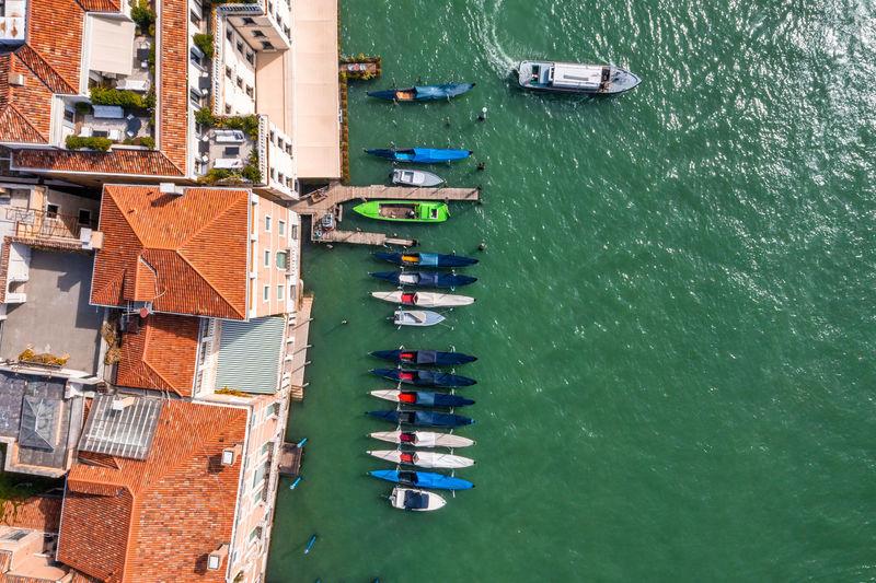 Top down view of moored empty venetian gondolas