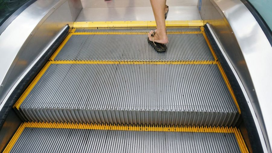 Low Section Of Woman In Escalator