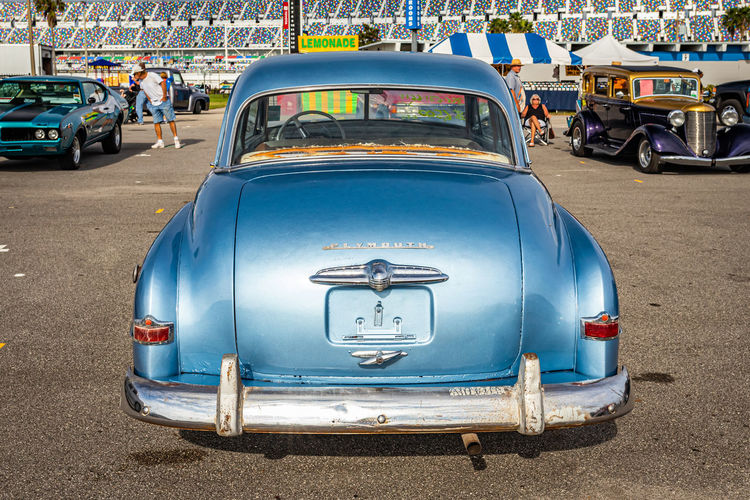 View of blue car on road