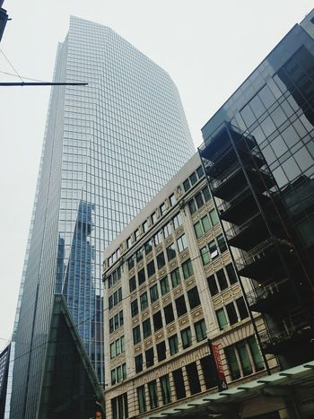 Reflect the Old Architecture Building Exterior City Skyscraper Business Finance And Industry Built Structure Sky No People Outdoors Low Angle View Cloud - Sky Day