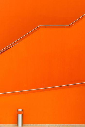 Orange railings against wall