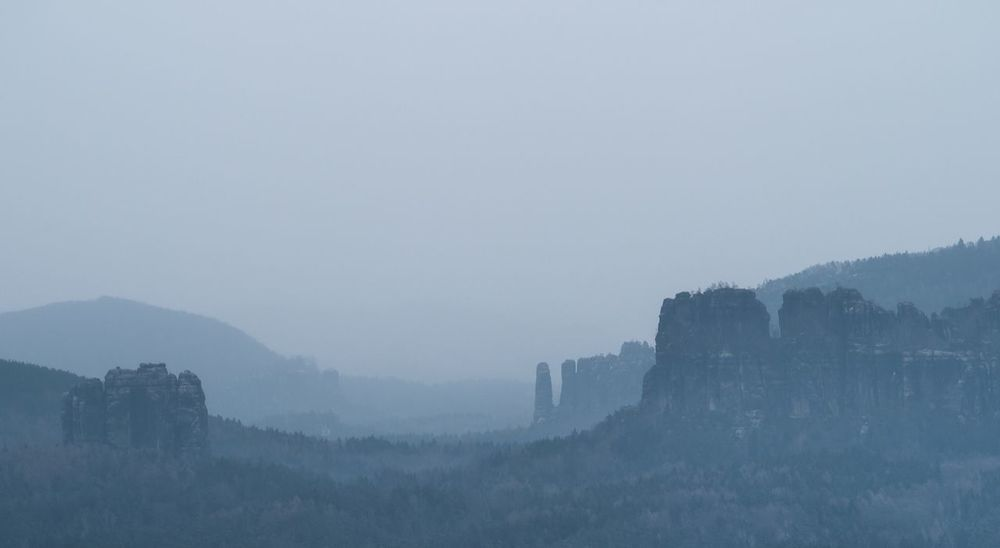 Schrammsteine in Saxonian Switzerland Fog Nature Copy Space Foggy Mountain Mist Tranquility Beauty In Nature Day Scenics Tranquil Scene Outdoors Landscape Hazy  Mountain Range Winter Sky No People