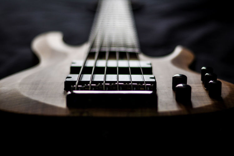 Beautiful natural light on my 6 string LTD bass. Gorgeous spalted maple top and flat black hardware makes these shots killer. 6string Bass Bass Guitar Bridge Close-up Contrast Depth Of Field Glow Guitar High Contrast Instruments Light Low Angle View Ltd Electric Guitar Maple Maple Top Music Musical Instruments Natural Light Pickups Selective Focus Single Object Six String Six Strings Warm