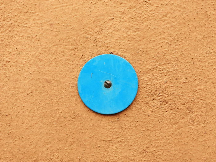 Circular Plate Mounted On Orange Wall