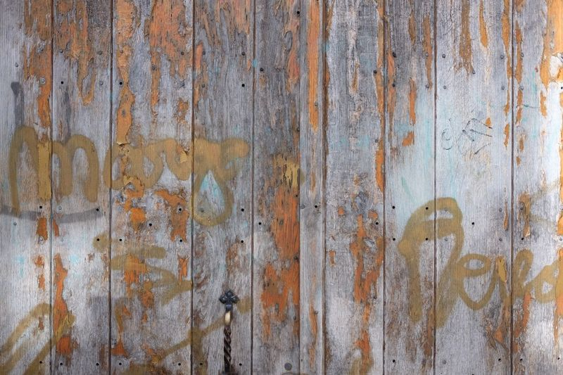 Detail shot of peeled wooden wall