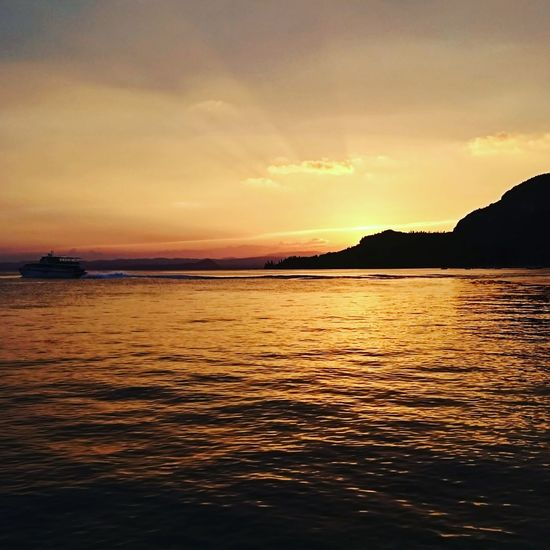 Gardasee Sunset Dramatic Sky Beauty In Nature Tranquil Scene Tranquility Travel Destinations Vacations Silhouette Landscape Nature Water Scenics Horizon Over Water Beauty