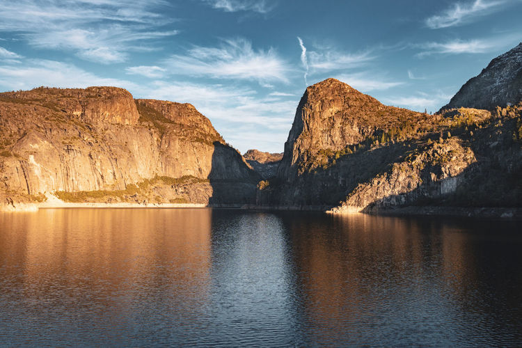 Hetch Hetchy Reservoir Scenics - Nature Water Sky Beauty In Nature Tranquil Scene Idyllic Rock Formation Mountain Range Outdoors Lake Reflection Reflections In The Water Blue Sky White Clouds Hetchhetchyreservoir California