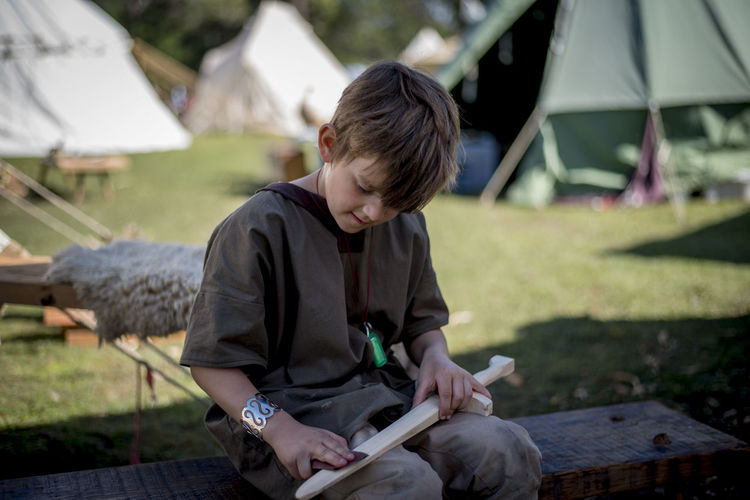 Boy Making Wooden Sword